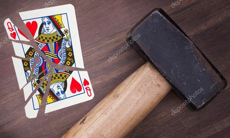 depositphotos_63958235-stock-photo-hammer-with-a-broken-card